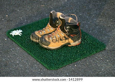 Hiking shoes on top of door mat, Olympic National Park, WA - stock photo