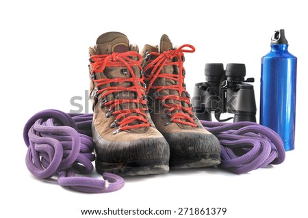 hiking shoes, rope,binoculars and water bottle on white background - stock photo