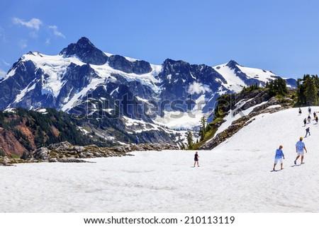 Hiking Summer Snowfields Glaciers Artist Point Mount Shuksan Mount Baker Highway Snow Mountain Washington State Pacific Northwest  - stock photo