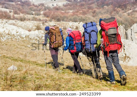 Hiking team in the mountains. travel sport lifestyle concept  - stock photo