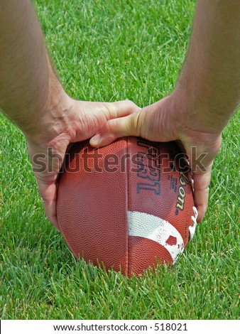 hiking the football - stock photo