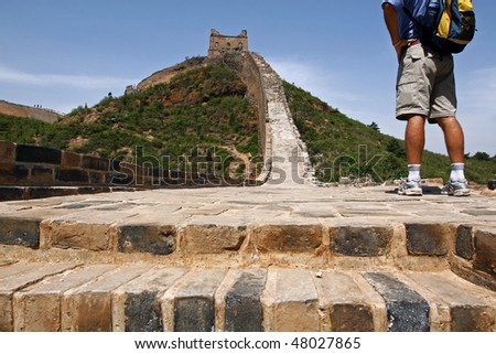 Hiking the Great Wall of China - stock photo