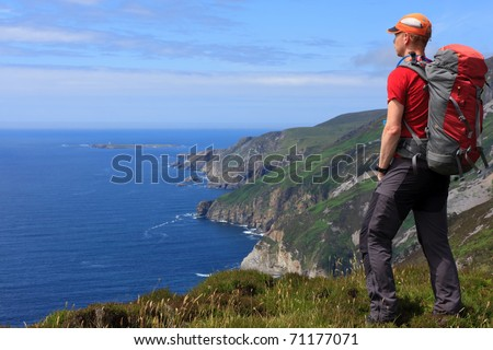 Hiking the Slieve League at the beautiful Atlantic coast in Donegal, Ireland. - stock photo