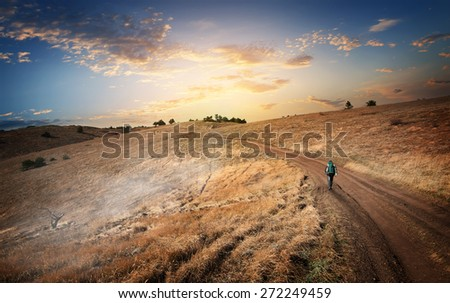 Hiking to the mountains in the autumn - stock photo