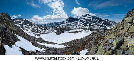 Hiking tour at Jotunheimen National Park (Norway) in July - stock photo