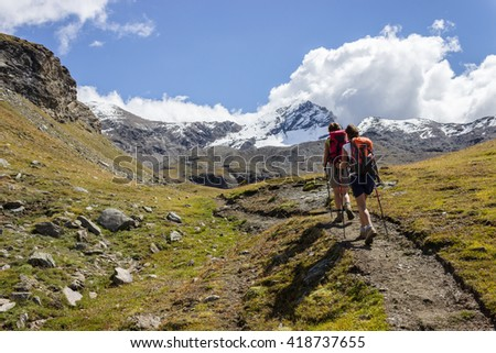 Hiking trail in Aosta Valley, Italy - stock photo