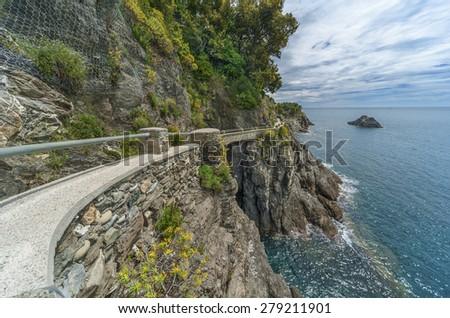 hiking trail in cliff in Resort Village Monterosso al Mare, Cinque Terre, Italy - stock photo