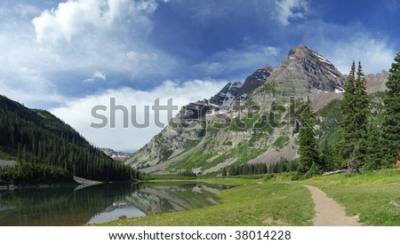 Hiking trail in Maroon Bells Wilderness in central Colorado - stock photo