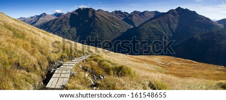Hiking trail in the Tyrolean Alps - stock photo