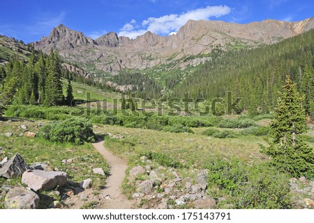 Hiking Trail into the Rocky Mountains, America - stock photo