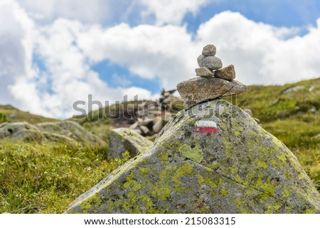 Hiking trail markers in France: cairn and blaze - stock photo