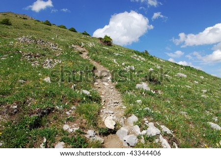 Hiking trail on the top of mountain indefatigable, kananaskis country, alberta, canada - stock photo