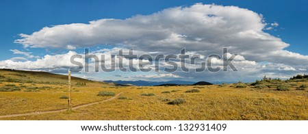 Hiking Trail Panorama with Dramatic Cloudscape - stock photo