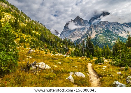 Hiking Trail thgrough the Beautiful Cascade Canyon - Grand Tetons - stock photo