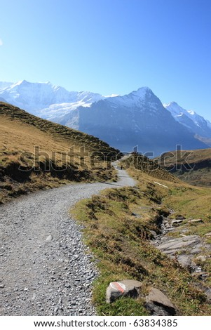 hiking trails leading to Jungfrau Swiss Alps, unesco world heritage in Switzerland - stock photo