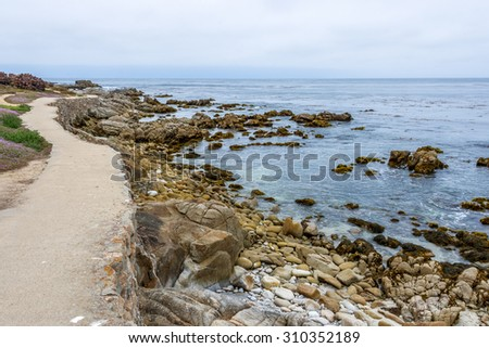 Hiking, walking, and biking on beautiful seaside trails and paths along the rugged Big Sur coastline, near Carmel and Monterey, CA. on the California Central Coast. - stock photo