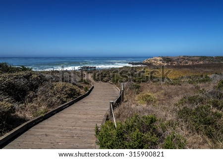 Hiking, walking, and biking on beautiful seaside trails and paths along the rugged Big Sur coastline, near Cambria,Carmel and Monterey, CA. on the California Central Coast. - stock photo