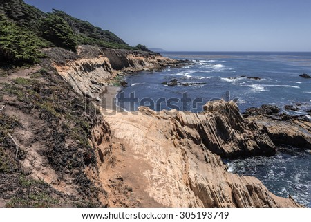 Hiking / walking, on forgotten, secret, hidden trails and paths along the rugged Big Sur coastline, near Carmel and Monterey, CA. on the California Central Coast. - stock photo