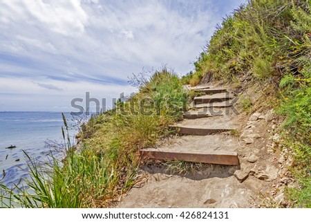Hiking / walking, on forgotten, secret, stairs, hidden trails and paths along the rugged Big Sur coastline, near Carmel and Monterey, CA. on the California Central Coast. - stock photo
