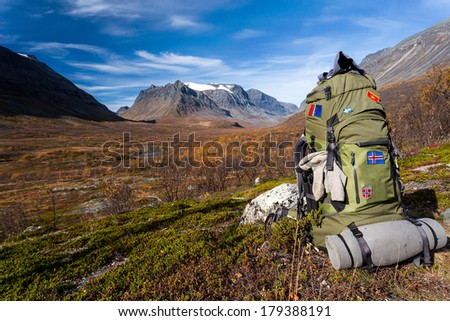 Hiking with backpack in the Vistasvaggi in Sweden - stock photo