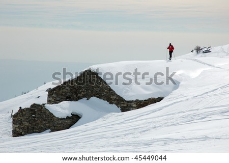 Hiking with snowshoes on a roof covered with snow, Mont Blanc. - stock photo