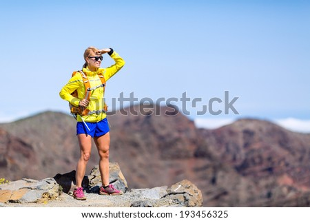 Hiking woman backpacker looking at view in mountains. Climbing, fitness and healthy lifestyle outdoors in summer nature on La Palma, Canary Islands - stock photo