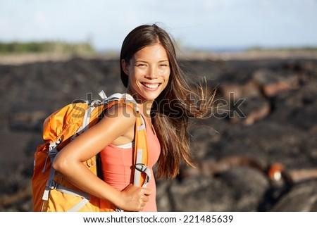 Hiking woman - hiker walking on lava field on Hawaii. Tourist on hike near Kilauea volcano around Hawaii volcanoes national park, USA. - stock photo