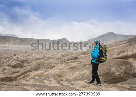Hiking woman on top happy and celebrating success. Female hiker on top of the world cheering in winning gesture having reached summit of mountain - stock photo