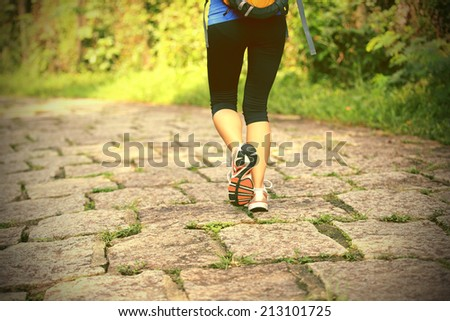 hiking woman walking on forest trail