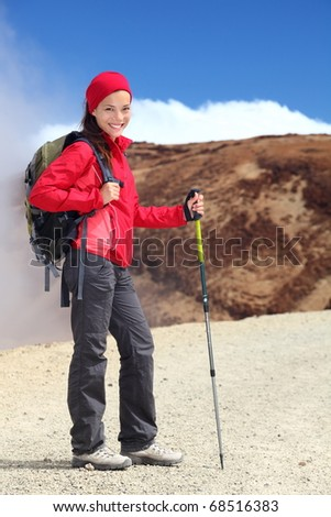 Hiking. Young woman hiker portrait. Beautiful outdoors person in walking on the volcano Teide, Tenerife, Canary Islands, Spain. - stock photo
