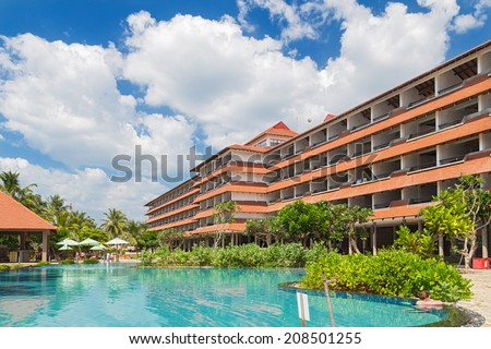 HIKKADUWA, SRI LANKA - FEBRUARY 24, 2014: Tourist in a pool in front of hotel resort. Hikkaduwa has a lot of guesthouses and hotels galore, from the cheap and cheerful to star-class. - stock photo