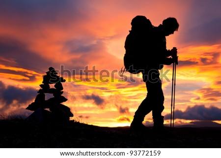 Hikking at Sunrise - stock photo