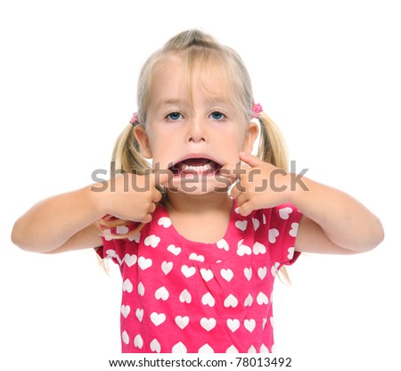 hilarious young girl pulls a funny face and shows her mouth - stock photo
