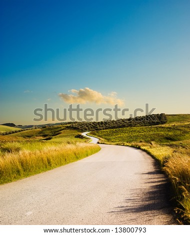 hill road at the twilight - stock photo