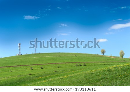 Hill with antennas and blue sky - stock photo