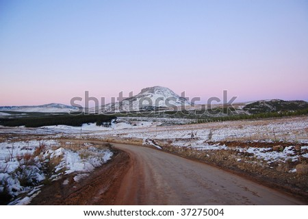 Hill with snow on at sunset, Hogsback, Amathole Mountains.