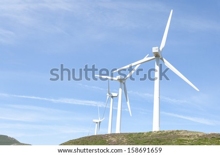 Hill with some wind turbines on a summer day