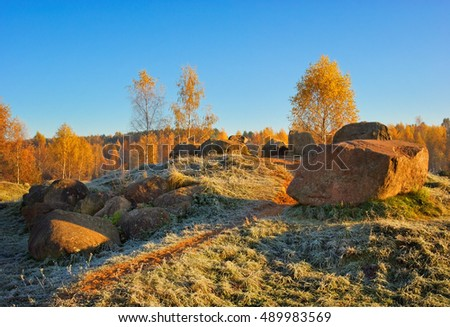 hill with the stones in the frosty autumn morning