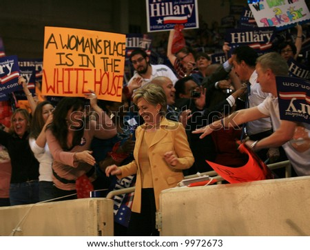 Hillary Clinton arrives at Rally in Dallas, surrounded by supporters. March 02, 2008 - stock photo