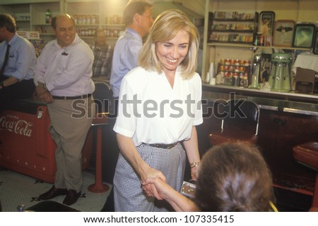 Hillary Rodham Clinton meets town's people at Dee's Restaurant during the Clinton/Gore 1992 Buscapade campaign tour in Corsicana, Texas - stock photo