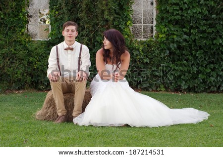 Hillbilly hipster vintage style bride and groom outside church after wedding ceremony - stock photo