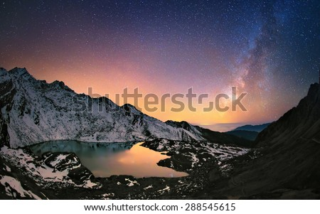 Hills around Gosaikunda lake (4,438 m) in Himalayas and the Milky Way galaxy above this sacred place. Nepal, Langtang region. - stock photo