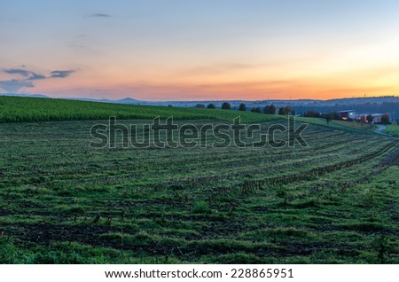 Hills at sundown in the fall - stock photo