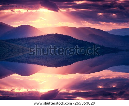 Hills glowing by warm sunlight at twilight. Dramatic scene. Carpathian, Ukraine, Europe. Beauty world. Retro and vintage style. Instagram toning effect. Flip canvas vertical. Double exposure effect. - stock photo