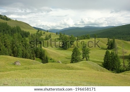 Hills landscape over a clouds - stock photo