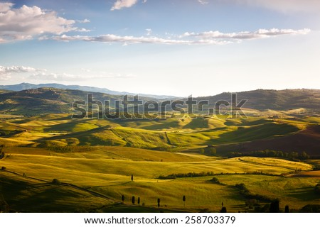 hills lit with the morning sun, a rural landscape in Tuscany, Italy - stock photo