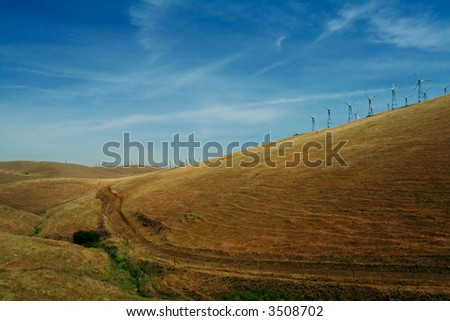 Hills of California. Pastures and wind turbines.