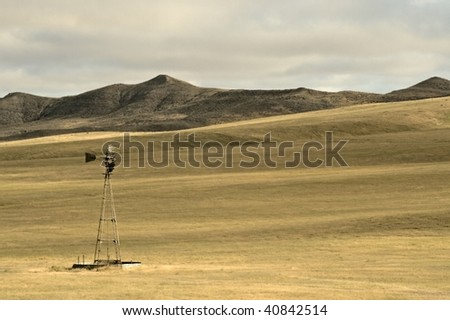 Hills Prairie and Windmill Nature Landscape Background.