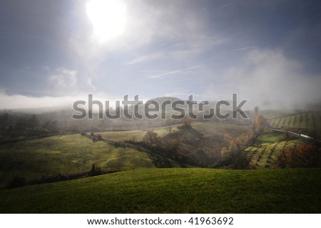 Hills shrouded in mist in the autumn months. Emilia Romagna, Italy - stock photo