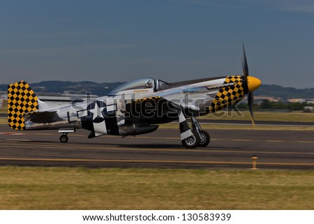 HILLSBORO, OR - AUG 5: Eddie Andreini demonstrates his P-51D Mustang during Oregon Air Show at Hillsboro Airport on August 5, 2012 in Hillsboro, OR. - stock photo
